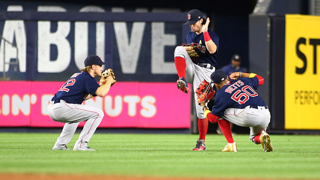 Boston Red Sox outfielders Brock Holt, Mookie Betts and Andrew Benintendi