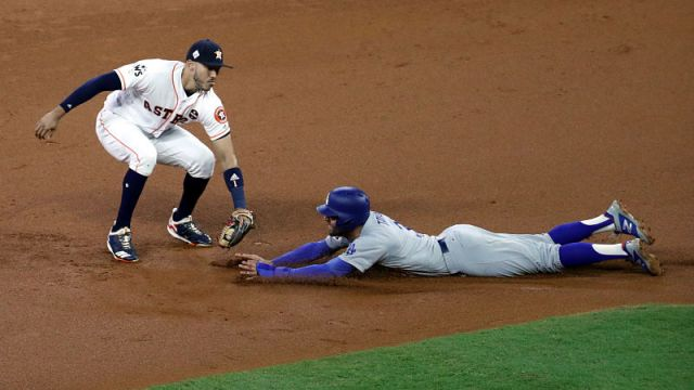 Houston Astros shortstop Carlos Correa and Los Angeles Dodgers center fielder Chris Taylor