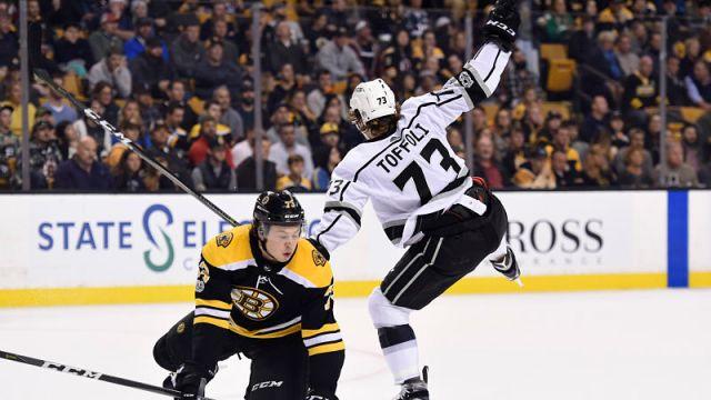 Boston Bruins defenseman Charlie McAvoy and Los Angles Kings center Tyler Toffoli