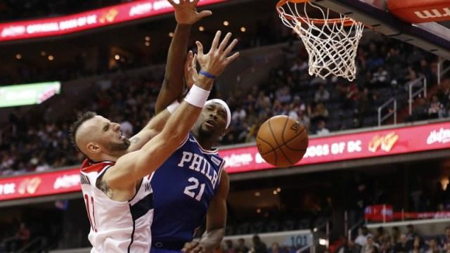 Washington Wizards center Marcin Gortat and Philadelphia 76ers center Joel Embiid