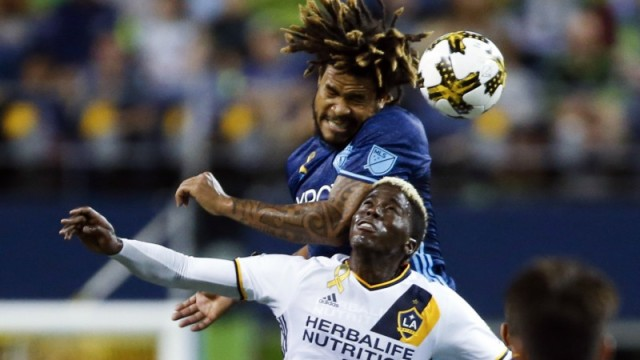 Seattle Sounders defender Roman Torres and Los Angeles Galaxy forward Gyasi Zardes