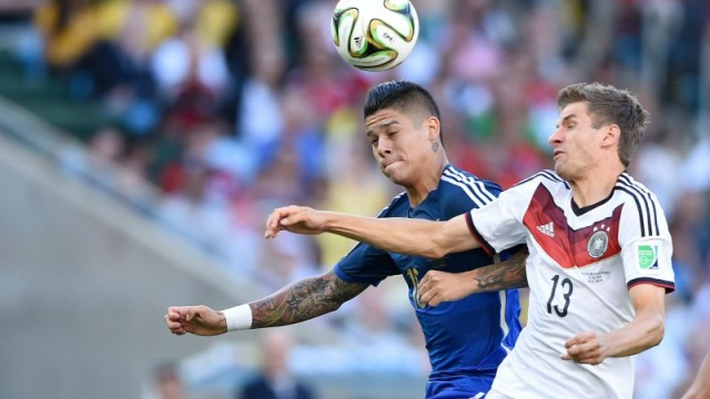 Argentina's Marcos Rojo and Germany's Thomas Muller