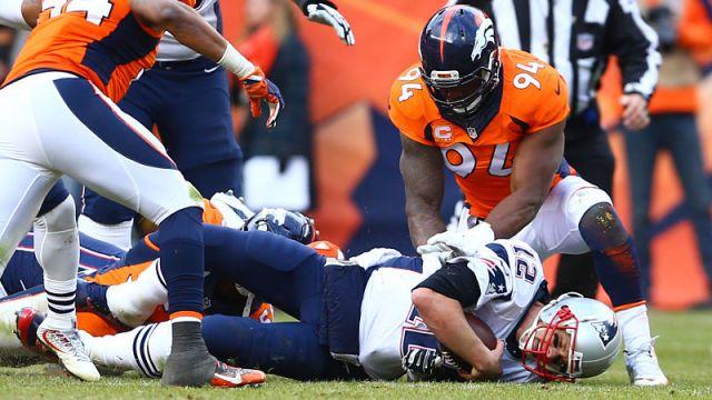 New England Patriots quarterback Tom Brady and Denver Broncos linebacker DeMarcus Ware