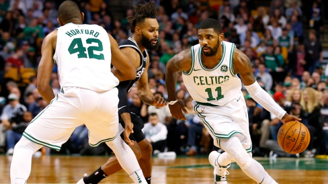 Kyrie Irving drives past Al Horford