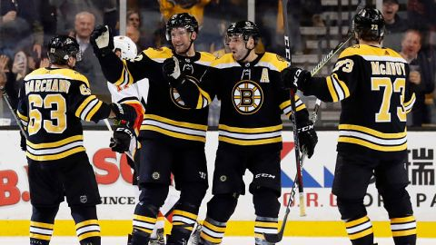 Boston bruins center Patrice Bergeron, wingers Brad Marchand and David Backes and defenseman Charlie McAvoy
