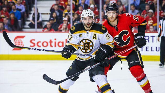 Boston Bruins forward Patrice Bergeron and Calgary Flames defenseman Dougie Hamilton