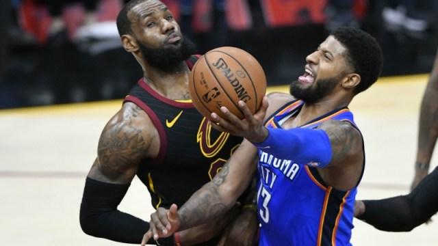 Oklahoma City Thunder forward Paul George and Cleveland Cavaliers forward LeBron James