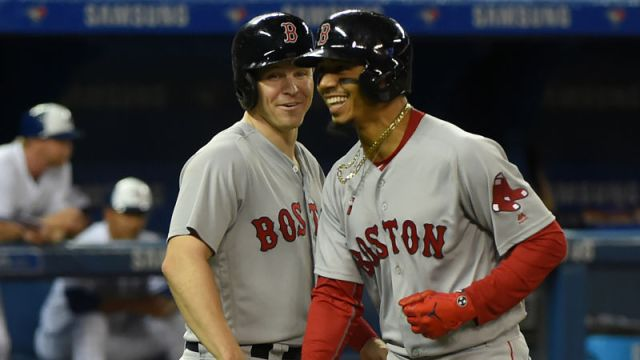 Boston Red Sox infielder Brock Holt and outfielder Mookie Betts