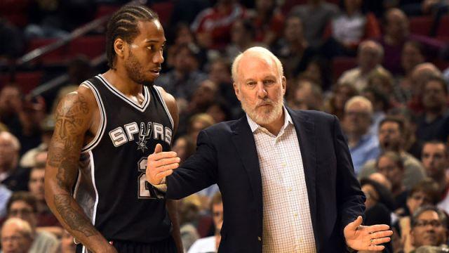 San Antonio Spurs forward Kawhi Leonard and head coach Gregg Popovich