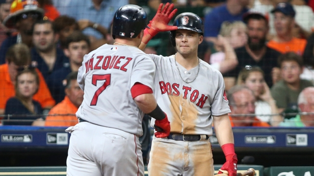 Boston Red Sox's Christian Vazquez And Andrew Benintendi