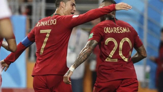 Portugal's Cristiano Ronaldo and Ricardo Quaresma