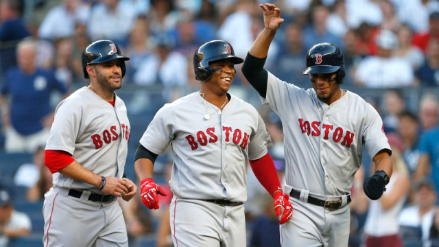 Boston Red Sox's Rafael Devers, Xander Bogaerts, J.D. Martinez