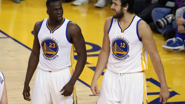 Golden State Warriors forward Draymond Green (23) and former center Andrew Bogut (12)