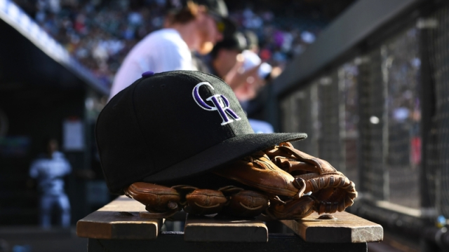 Cap and glove of a Colorado Rockies player