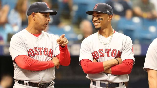 Boston Red Sox manager Alex Cora and outfielder Mookie Betts