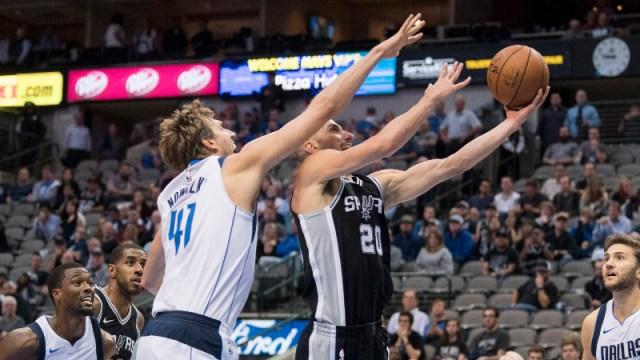 San Antonio Spurs guard Manu Ginobili (20) and Dallas Mavericks forward Dirk Nowitzki (41)