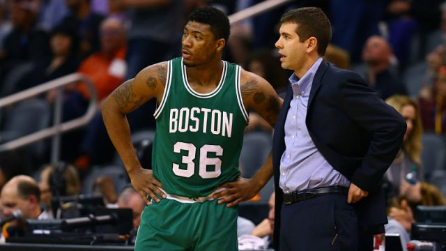 Boston Celtics guard Marcus Smart and head coach Brad Stevens