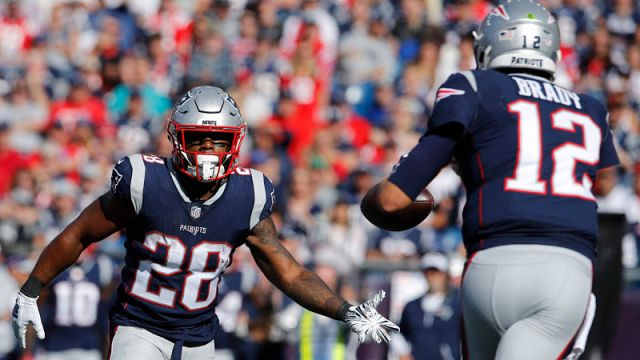New England Patriots running back James White and quarterback Tom Brady