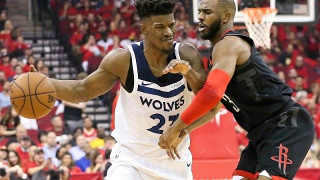 Minnesota Timberwolves guard Jimmy Butler (23) and Houston Rockets guard Chris Paul