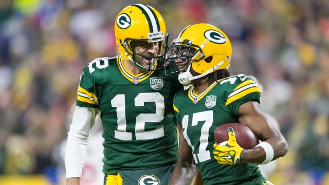 Green Bay Packers quarterback Tom Brady and wide receiver Davante Adams