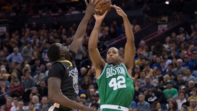 Boston Celtics forward Al Horford (42) and Golden State Warriors forward Draymond Green (23)
