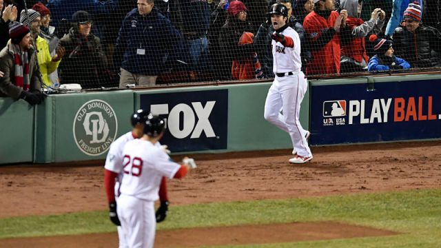 Boston Red Sox outfielders Andrew Benintendi and J.D. Martinez