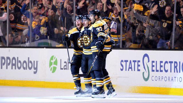 Boston Bruins forwards David Pastrnak, Brad Marchand and Patrice Bergeron