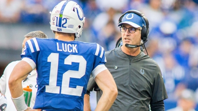 Frank Reich talks with Andrew Luck