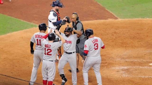 Boston Red Sox's Brock Holt, Sandy Leon, Rafael Devers and Jackie Bradley Jr.