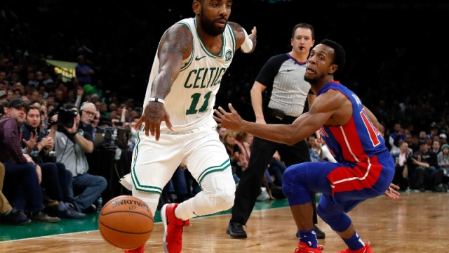Boston Celtics guard Kyrie Irving (11) and Detroit Pistons guard Ish Smith