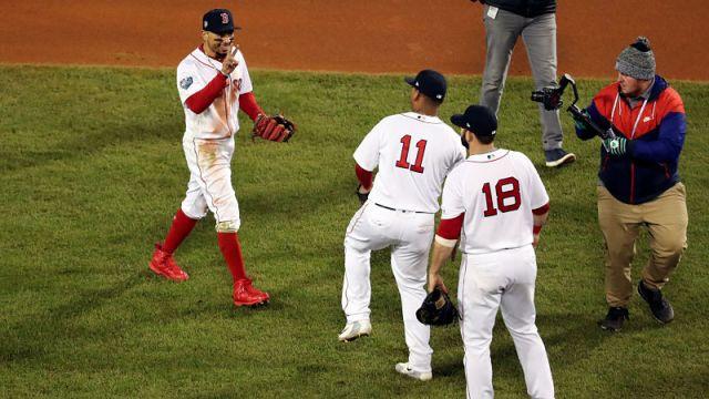 Boston Red Sox right fielder Mookie Betts, third baseman Rafael Devers and first baseman Mitch Moreland