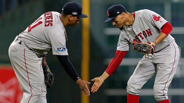 Boston Red Sox outfielder Mookie Betts and third baseman Rafael Devers