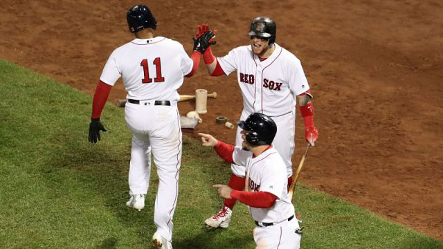 Boston Red Sox third baseman Rafael Devers, catcher Christian Vazquez and first baseman Steve Pearce