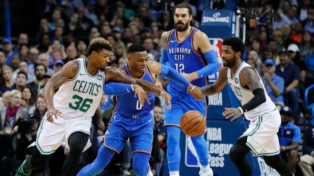 Oklahoma City Thunder guard Russell Westbrook and Boston Celtics guards Kyrie Irving and Marcus Smart