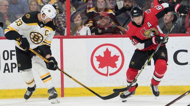 Boston Bruins defenseman Zdeno Chara and Ottawa Senators winger Mark Stone