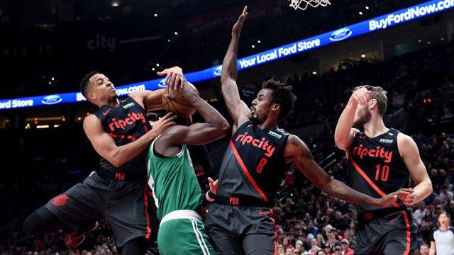 Boston Celtics guard Jaylen Brown and Portland Trail Blazers guard CJ McCollum