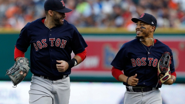 Boston Red Sox outfielders J.D. Martinez (28) and LA Dodgers Outfielder Mookie Betts (50)