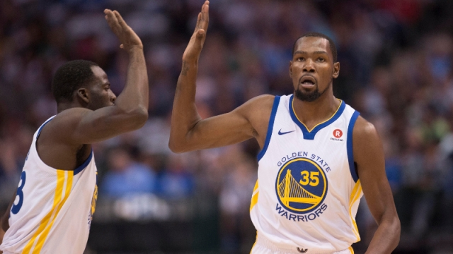 Golden State Warriors forwards Draymond Green (23) and Kevin Durant (35)