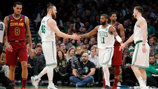 Boston Celtics guard Kyrie Irving, center Aron Baynes and forward Gordon Hayward