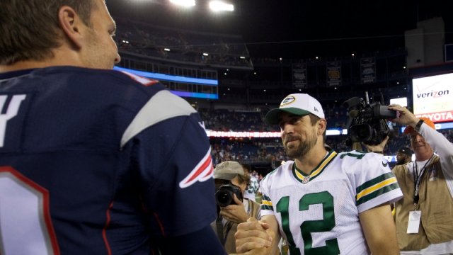 New England Patriots quarterback Tom Brady (12) and Green Bay Packers quarterback Aaron Rodgers (12)