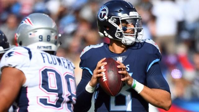 Patriots defensive end Trey Flowers, Titans quarterback Marcus Mariota