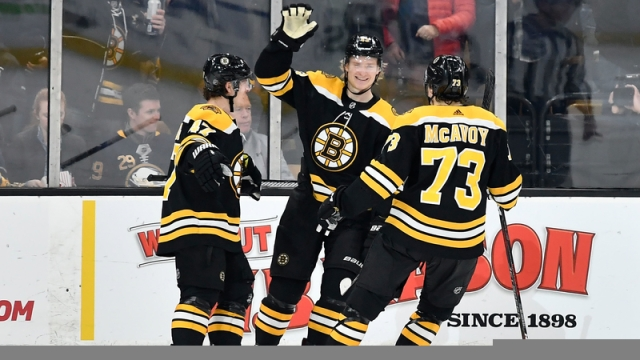 Boston Bruins' Torey Krug, Danton Heinen And Charlie McAvoy