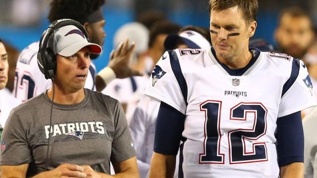 Patriots wide receivers coach Chad O'Shea, quarterback Tom Brady