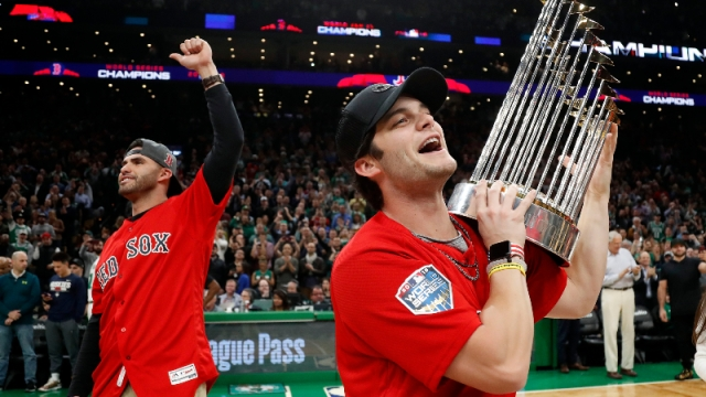 Boston Red Sox outfielder Andrew Benintendi (right) and designated hitter J.D. Martinez