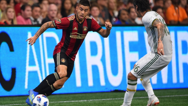 Atlanta United forward Hector Villalba (left) and Portland Timbers defender Zarek Valentin