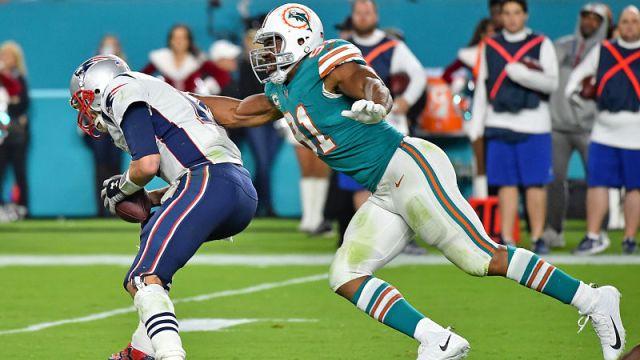 New England Patriots quarterback Tom Brady and Miami Dolphins defensive end Cameron Wake