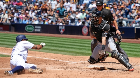 San Diego Padres third baseman Yangervis Solarte (left) and Miami Marlins catcher J.T. Realmuto