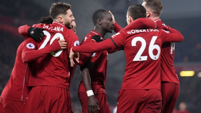 Liverpool forward Sadio Mane (center) and teammates