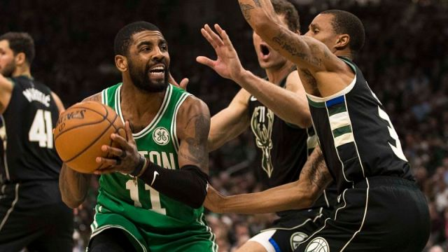 Boston Celtics guard Kyrie Irving and Milwaukee Bucks guard George Hill