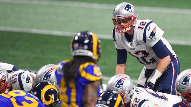 Los Angeles Rams defensive back Marqui Christian and New England Patriots quarterback Tom Brady